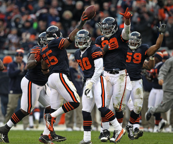 CHICAGO - NOVEMBER 14: Members of the Chicago Bear defense including (L-R) Lance Briggs #55, D.J.Moore #30, Julius Peppers #90 and Pisa Tinoisamoa #59 celebrate Brigg's interception against the Minnesota Vikings at Soldier Field on November 14, 2010 in Ch