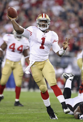 GLENDALE, AZ - NOVEMBER 29:  Quarterback Troy Smith #1 of the San Francisco 49ers throws a pass during the first quarter of the NFL game against the Arizona Cardinals at the University of Phoenix Stadium on November 29, 2010 in Glendale, Arizona.  (Photo