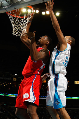 NEW ORLEANS - NOVEMBER 09:  DeAndre Jordan #9 of the Los Angeles Clippers dunks the ball over Willie Green #32 of the New Orleans Hornets at the New Orleans Arena on November 9, 2010 in New Orleans, Louisiana. The Hornets defeated the Clippers 101-82.   N