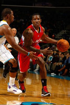 NEW ORLEANS - NOVEMBER 09:  Eric Bledsoe #12 of the Los Angeles Clippers drives the ball around Chris Paul #3 of the New Orleans Hornets at the New Orleans Arena on November 9, 2010 in New Orleans, Louisiana. The Hornets defeated the Clippers 101-82.   NO