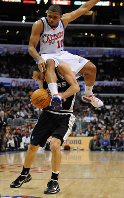 LOS ANGELES, CA - DECEMBER 13:  Eric Gordon #10 of the Los Angeles Clippers lands on Manu Ginobili #20 of the San Antonio Spurs attempting to block his shot during the game at Staples Center on December 13, 2009 in Los Angeles, California.  The Spurs won