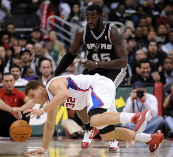 LOS ANGELES, CA - DECEMBER 01:  Blake Griffin #32 of the Los Angeles Clippers keeps his dribble as he falls in front of DeJuan Blair #45 of the San Antonio Spurs during a 90-85 Clipper win at the Staples Center on December 1, 2010 in Los Angeles, Californ