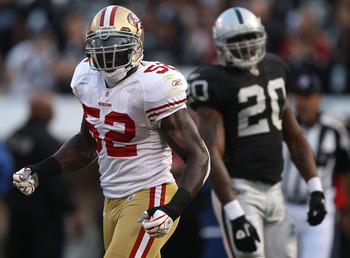 OAKLAND, CA - AUGUST 28: Patrick Willis #52 of the San Francisco 49ers celebrates after stopping Darren McFadden #20 of the Oakland Raiders for a loss during an NFL preseason game at Oakland-Alameda County Coliseum on August 28, 2010 in Oakland, Californi