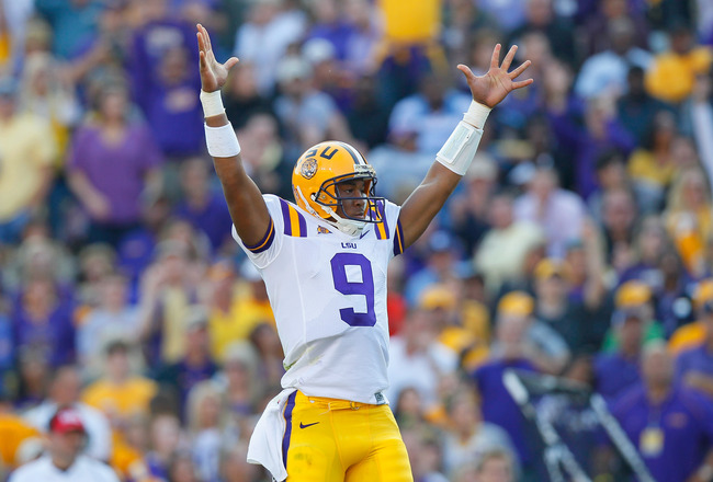 BATON ROUGE, LA - NOVEMBER 20:  Quarterback Jordan Jefferson #9 of the Louisiana State University Tigers reacts after scoring a touchdown against the Ole Miss Rebels at Tiger Stadium on November 20, 2010 in Baton Rouge, Louisiana.  (Photo by Kevin C. Cox/