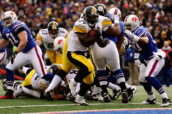 ORCHARD PARK, NY - NOVEMBER 28:  Rashard Mendenhall #34 of the Pittsburgh Steelers rushes for a touchdown against the Buffalo Bills at Ralph Wilson Stadium on November 28, 2010 in Orchard Park, New York.  (Photo by Karl Walter/Getty Images)