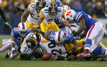 ORCHARD PARK, NY - NOVEMBER 28:  Players from the Buffalo Bills and the Pittsburgh Steelers scramble to try and recover a fumble by Leodis McKelvin #28 of the Bills at Ralph Wilson Stadium at Ralph Wilson Stadium on November 28, 2010 in Orchard Park, New