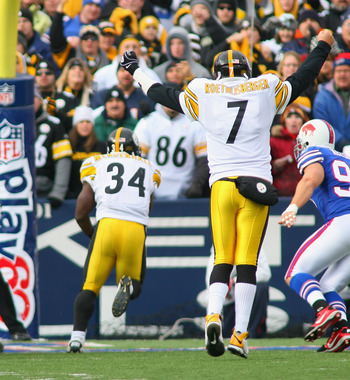 ORCHARD PARK, NY - NOVEMBER 28:  Ben Roethlisberger #7 of the Pittsburgh Steelers signals a touchdown as Rashard Mendenhall #34 scores against the Buffalo Bills on November 28, 2010 at Ralph Wilson Stadium in Orchard Park, New York.  (Photo by Rick Stewar