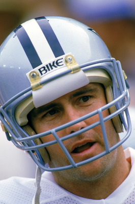 ANAHEIM -1986:  Quarterback Danny White #11 of the Dallas Cowboys talks on the sidelines during a playoff game against the Los Angeles Rams at Anaheim Stadium on January 1,1986 in Anaheim, California. The Rams defeated the Cowboys 20-0.  (Photo by: Mike P