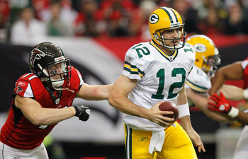 ATLANTA - NOVEMBER 28:  Kroy Biermann #71 of the Atlanta Falcons chases down Aaron Rodgers #12 of the Green Bay Packers at Georgia Dome on November 28, 2010 in Atlanta, Georgia.  (Photo by Kevin C. Cox/Getty Images)