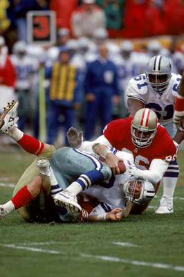 SAN FRANCISCO - JANUARY 17:  Quarterback Troy Aikman #8 of the Dallas Cowboys gets sacked during the 1992 NFC Conference Championship game against the San Francisco 49ers at Candlestick Park on January 17, 1993 in San Francisco, California.  The Cowboys w