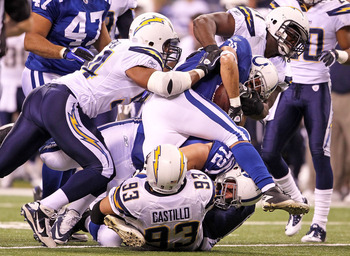 INDIANAPOLIS - NOVEMBER 28:  Donald Brown #31 of the Indianapolis Colts is tackled by Luis Castillo #93 of the San Diego Chargers during the NFL game at Lucas Oil Stadium on November 28, 2010 in Indianapolis, Indiana.  (Photo by Andy Lyons/Getty Images)