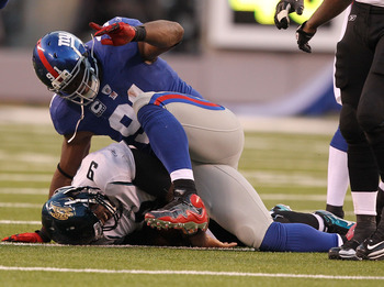 EAST RUTHERFORD, NJ - NOVEMBER 28:  Justin Tuck #91 of the New York Giants sacks David Garrard #9 of the Jacksonville Jaguars during their game on November 28, 2010 at The New Meadowlands Stadium in East Rutherford, New Jersey.  (Photo by Al Bello/Getty I