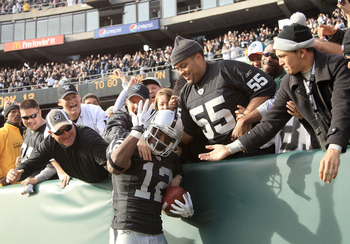 OAKLAND, CA - NOVEMBER 28:  Jacoby Ford #12 of the Oakland Raiders is congratulated by fans after he scored a touchdown against the Miami Dolphins at Oakland-Alameda County Coliseum on November 28, 2010 in Oakland, California.  (Photo by Ezra Shaw/Getty I