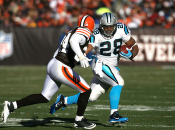CLEVELAND - NOVEMBER 28:  Running back Jonathan Stewart #28 of the Carolina Panthers runs by defensive back Sheldon Brown #24 of the Cleveland Browns at Cleveland Browns Stadium on November 28, 2010 in Cleveland, Ohio.  (Photo by Matt Sullivan/Getty Image