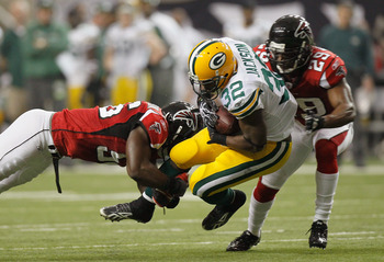 ATLANTA - NOVEMBER 28:  Sean Weatherspoon #56 and Brian Williams #29 of the Atlanta Falcons tackle Brandon Jackson #32 of the Green Bay Packers at Georgia Dome on November 28, 2010 in Atlanta, Georgia.  (Photo by Kevin C. Cox/Getty Images)