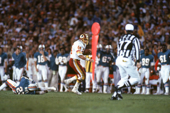 PASADENA, CA - JANUARY 30:  Running back John Riggins #44 of the Washington Redskins rushes for yards during Super Bowl XVII against the Miami Dolphins at the Rose Bowl on January 30, 1983 in Pasadena, California.  John Riggins was named Super Bowl MVP as