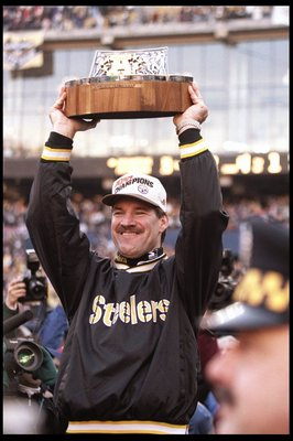 14 Jan 1996: Pittsburgh Steelers head coach Bill Cowher holds the trophy after a playoff game against the Indianapolis Colts at Three Rivers Stadium in Pittsburgh, Pennsylvania. The Steelers won the game, 20-16.