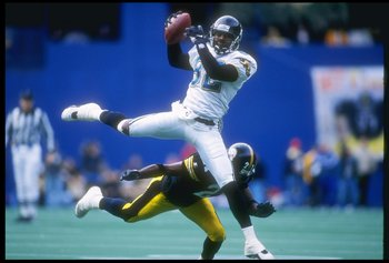 17 Nov 1996:  Wide receiver Jimmy Smith of the Jacksonville Jaguars makes a catch as cornerback Deon Figures of the Pittsburgh Steelers falls down during a game at Three Rivers Stadium in Pittsburgh, Pennsylvania.  The Steelers won the game 28-3. Mandator