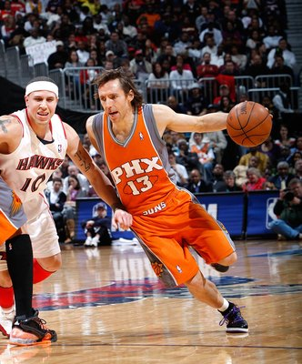 ATLANTA - JANUARY 15:  Steve Nash #13 of the Phoenix Suns against Mike Bibby #10 of the Atlanta Hawks at Philips Arena on January 15, 2010 in Atlanta, Georgia.  NOTE TO USER: User expressly acknowledges and agrees that, by downloading and/or using this Ph