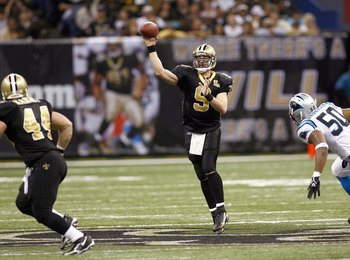 NEW ORLEANS - DECEMBER 31: Drew Brees #9 of the New Orleans Saints passes the ball during the game against the Carolina Panthers on December 31, 2006 at the Superdome in New Orleans, Louisiana. The Panthers defeated the Saints 31-21. (Photo by Chris Grayt