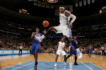 DENVER - NOVEMBER 17:  Carmelo Anthony #15 of the Denver Nuggets follows through as he dunks against the New York Knicks at the Pepsi Center November 17, 2007 in Denver, Colorado.  (Photo by Doug Pensinger/Getty Images)