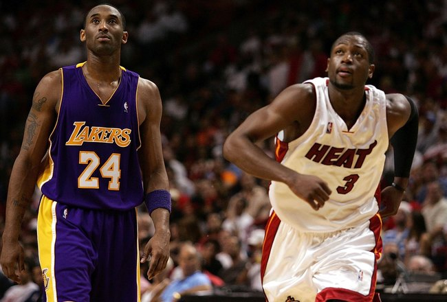 MIAMI - DECEMBER 25:  Guard Dwyane Wade #3 of the Miami Heat and guard Kobe Bryant #24 of the Los Angeles Lakers look up for a rebound on December 25, 2006 at the American Airlines Arena in Miami, Florida.  NOTE TO USER: User expressly acknowledges and ag