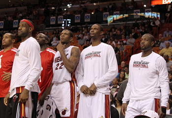 MIAMI, FL - DECEMBER 01: (L-R) LeBron James #6, James Jones #22, Chris Bosh #1, and Dwyane Wade #3 of the Miami Heat look on during a game against the Detroit Pistons at American Airlines Arena on December 1, 2010 in Miami, Florida. NOTE TO USER: User exp