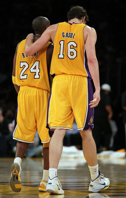 LOS ANGELES, CA - NOVEMBER 02:  Pau Gasol #16 of the Los Angeles Lakers puts his arm around teammate Kobe Bryant #24 during the game against the Memphis Grizzlies at Staples Center on November 2, 2010 in Los Angeles, California. The Lakers defeated the Gr