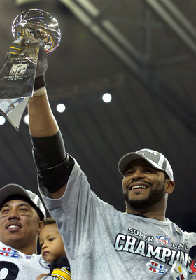 Pittsburgh Steeler Jerome Bettis celebrates with the Super Bowl Trophy after winning Super Bowl XL between the Pittsburgh Steelers and Seattle Seahawks at Ford Field in Detroit, Michigan on February 5, 2006. (Photo by A. Messerschmidt/Getty Images)