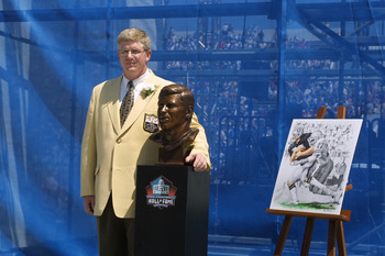 CANTON, OHIO - AUGUST 3:  Dave Casper stands next to his bust and artwork after his induction into the National Football League Hall of Fame on August 3, 2002 at Fawcett Stadium in Canton, Ohio.  Dave Casper played tight end from 1974 to 1984 for the Oakl