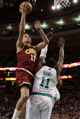 BOSTON - MAY 09:  Anderson Varejao #17 of the Cleveland Cavaliers heads for the basket as Glen Davis #11 of the Boston Celtics defends during Game Four of the Eastern Conference Semifinals of the 2010 NBA playoffs at TD Garden on May 9, 2010 in Boston, Ma