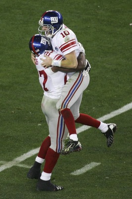 GLENDALE, AZ - FEBRUARY 03:  Quarterback Eli Manning #10 of the New York Giants celebrates with running back Brandon Jacobs #27 after Manning throws to wide receiver Plaxico Burress #17 of the New York Giants as Burress catches a 13-yard touchdown pass in
