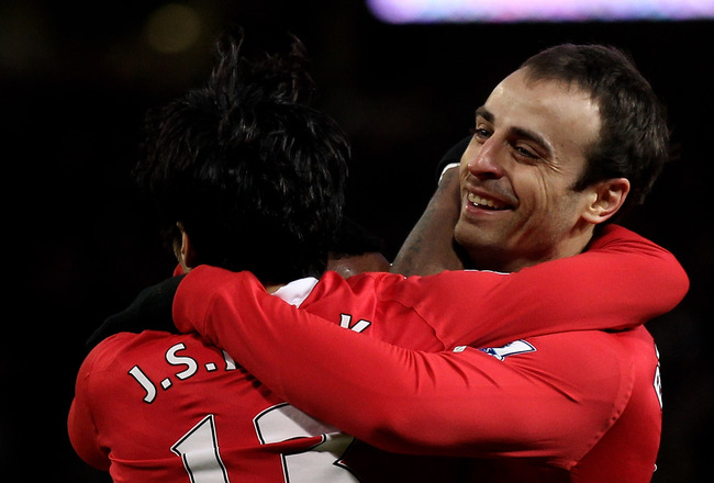 MANCHESTER, ENGLAND - NOVEMBER 27:  Dimitar Berbatov of Manchester United is congratulated by his team mates after scoring his team's fourth goal to secure his hat trick during the Barclays Premier League match between Manchester United and Blackburn Rove