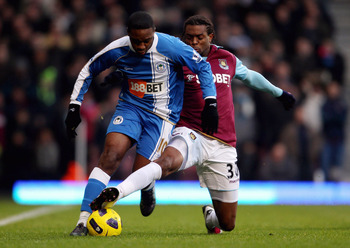 LONDON, ENGLAND - NOVEMBER 27: West Ham's Frederic Piquionne (R) in action with Wigan's Charles N'Zogbia during the Barclays Premier League match between West Ham United and Wigan Athletic at Boleyn Ground on November 27, 2010 in London, England.  (Photo