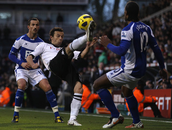 LONDON, ENGLAND - NOVEMBER 27:  Keith Fahey of Birmingham City tries to tackle Simon Davies of Fulham during the Barclays Premier League match between Fulham and Birmingham City at Craven Cottage on November 27, 2010 in London, England.  (Photo by Ian Wal