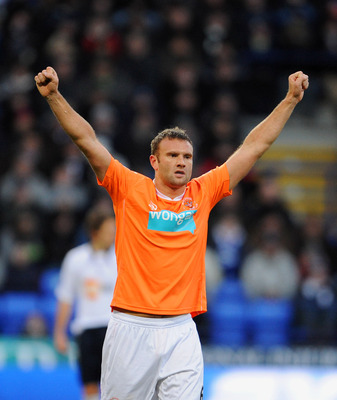 BOLTON, UNITED KINGDOM - NOVEMBER 27: Ian Evatt of Blackpool celebrates after scoring his sides first goal during the Barclays Premier League match between Bolton Wanderers and Blackpool at the Reebok Stadium on November 27, 2010 in Bolton, England. (Phot