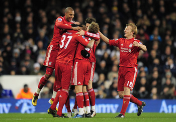 LONDON, ENGLAND - NOVEMBER 28:  Dirk Kuyt of Liverpool (R) joins his team mates as they celebrate the opening goal by Martin Skrtel during the Barclays Premier League match between Tottenham Hotspur and Liverpool at White Hart Lane on November 28, 2010 in