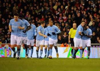 STOKE ON TRENT, ENGLAND - NOVEMBER 27:  Micah Richards of Manchester City is congratulated on his goal during the Barclays Premier League match between Stoke City and Manchester City at Britannia Stadium on November 27, 2010 in Stoke on Trent, England.  (