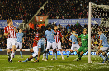 STOKE ON TRENT, ENGLAND - NOVEMBER 27:  Ryan Shawcross of Stoke City has a shot saved on the line by the Manchester City defence during the Barclays Premiership match between Stoke City and Manchester City at Britannia Stadium on November 27, 2010 in Stok