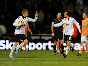 BOLTON, UNITED KINGDOM - NOVEMBER 27: Mark Davies (R) of Bolton  celebrates after scoring the second goal for his side during the Barclays Premier League match between Bolton Wanderers and Blackpool at the Reebok Stadium on November 27, 2010 in Bolton, En