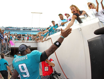 JACKSONVILLE, FL - NOVEMBER 21:  David Garrard #9  of the Jacksonville Jaguars is congratulated by fans after winning a game agaisnt the Cleveland Browns at EverBank Field on November 21, 2010 in Jacksonville, Florida.  (Photo by Mike Ehrmann/Getty Images