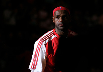 MIAMI, FL - DECEMBER 01:  LeBron James #6 of the Miami Heat looks on during a game against the Detroit Pistons at American Airlines Arena on December 1, 2010 in Miami, Florida. NOTE TO USER: User expressly acknowledges and agrees that, by downloading and/