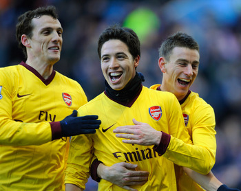 BIRMINGHAM, ENGLAND - NOVEMBER 27:  Samir Nasri of Arsenal celebrates scoring to make it 2-0 with team mates Sebastien Squillaci and Laurent Koscielny during the Barclays Premier League match between Aston Villa and Arsenal at Villa Park on November 27, 2