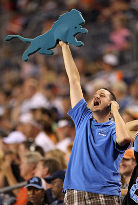 DENVER - AUGUST 21:  A Detroit Lions fans celebrates as the Lions face the Denver Broncos during preseason NFL action at INVESCO Field at Mile High on August 21, 2010 in Denver, Colorado. The Lions defeated the Broncos 25-20.  (Photo by Doug Pensinger/Get