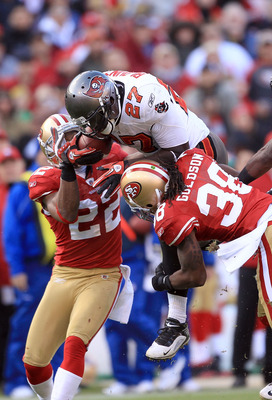 SAN FRANCISCO - NOVEMBER 21:  LeGarrette Blount #27 of the Tampa Bay Buccaneers is hit by Dashon Goldson #38 and Nate Clements #22 of the San Francisco 49ers at Candlestick Park on November 21, 2010 in San Francisco, California.  (Photo by Ezra Shaw/Getty