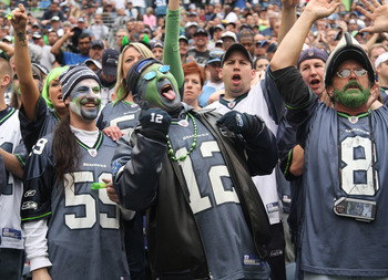 SEATTLE - SEPTEMBER 26:  Fans of the Seattle Seahawks cheer during the game against the San Diego Chargers at Qwest Field on September 26, 2010 in Seattle, Washington. The Seahawks defeated the Chargers 27-20. (Photo by Otto Greule Jr/Getty Images)