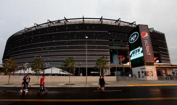 EAST RUTHERFORD, NJ - AUGUST 16:  Fans walk into the New Meadowlands Stadium for a preseason game between the New York Jets and New York Giants on August 16, 2010 in East Rutherford, New Jersey.  (Photo by Andrew Burton/Getty Images)