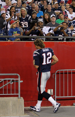 FOXBORO, MA - AUGUST 12: Fans cheer as Tom Brady # 12 of the New England Patriots leaves the field in the final minutes of a 27 - 24 win over the New Orleans Saints in a preseason game at Gillette Stadium on August 12, 2010 in Foxboro, Massachusetts. (Pho
