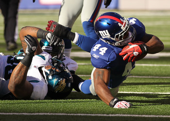 EAST RUTHERFORD, NJ - NOVEMBER 28:  Ahmad Bradshaw #44 of the New York Giants runs with the ball as Courtney Greene #36 of the Jacksonville Jaguars attempts the tackle during their game on November 28, 2010 at The New Meadowlands Stadium in East Rutherfor