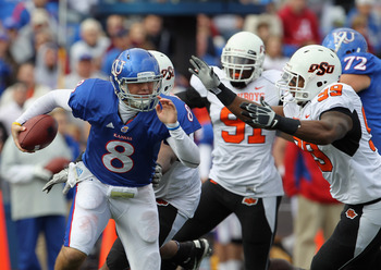The OSU defense chases down Kansas quarterback Quinn Mecham